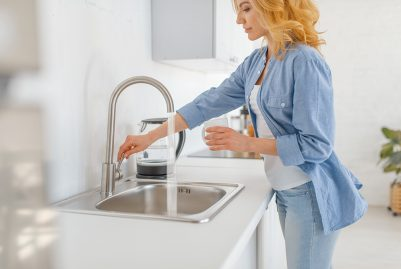 Women next to kitchen sink